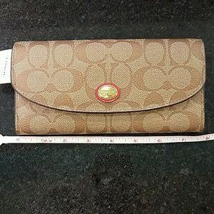 COACH Peyton Signature Slim Envelope Wallet